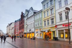 Grosse Strasse in Flensburg, Germany. Flensburg, Germany - February 8, 2017:  Grosse Strasse in Flensburg. It is a shopping street in center of the city, which Stock Photography