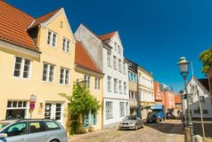 Flensburg, Germany: One of the streets of the city with colored houses royalty free stock photo