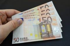 Flera femtio euro i hand Packe av euros Royaltyfri Foto