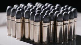 Flera rader av pistolkulor arkivfoto
