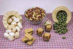 Flera typiska brasilianska sötsaker från Junina Jordnöt kokosnöt ca Royaltyfri Fotografi