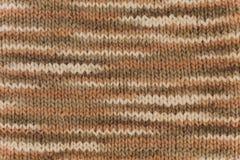 Flerfärgad stucken bakgrund från woolen garner Handgjort texturerat Royaltyfri Foto
