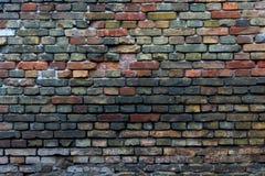 Flerfärgad tegelstenvägg Arkivbild