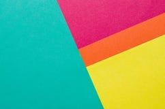 Flerfärgade ark av pappersabstrakt begreppbakgrund Arkivfoto