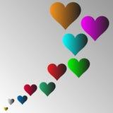 Flerfärgade hjärtor med grå bakgrund Arkivfoton