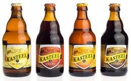Fles Belgische Kasteel Tripel, Donker, Blonde en Rood bier Stock Foto's