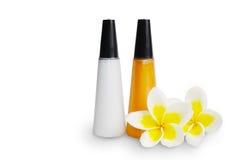 Fles en frangipani flowers spa   Stock Afbeelding
