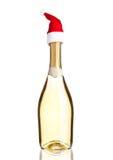 Fles gele champagne met het wit van de santahoed Stock Afbeelding