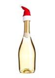 Fles gele champagne met het wit van de santahoed Royalty-vrije Stock Afbeelding