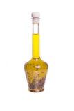 Fles kruidige olijfolie Stock Foto's