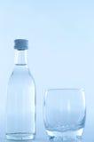 Fles met glas Stock Afbeelding