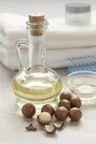 Fles met macadamia olie Royalty-vrije Stock Foto