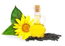Fles met olie en zaden Stock Foto's