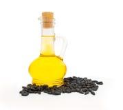 Fles met olie en zonnebloemzaden Stock Afbeeldingen