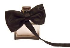 Fles parfum met een smokingboog Stock Fotografie