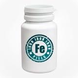 Fles van pillen met ijzerfe Royalty-vrije Stock Foto