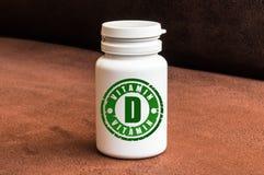 Fles van pillen met vitamine D royalty-vrije stock foto
