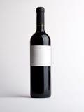 Fles van wijnstok met leeg etiket Stock Afbeelding