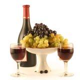 Fles wijn, glas, druiven Stock Foto's