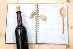 Fles wijn op kalender Royalty-vrije Stock Foto