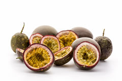Flesh Of Halved Passionfruits In Their Hard Rind. Juicy inner fruit flesh and seeds of several halved passionfruits presented in their hard outer rind. Rich in royalty free stock photography