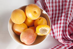 The Fleshy apricots in the bowl on the table. Fleshy apricots in the bowl on the table Royalty Free Stock Photos