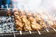Fleshy kebab roasting on mangal Royalty Free Stock Photo