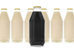 Flessen melk en vloeistof Royalty-vrije Stock Afbeeldingen