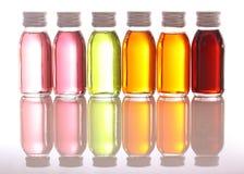 Flessen met essentiële oliën Stock Afbeelding