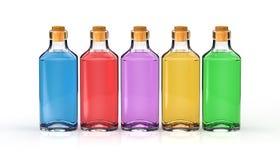 Flessen met grondbeginselenoliën Royalty-vrije Stock Foto