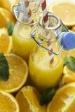 flessen met sinaasappel Royalty-vrije Stock Foto's