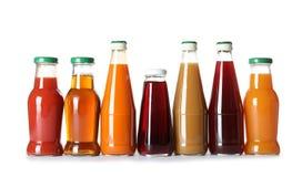 Flessen met verschillende dranken stock afbeelding