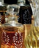 Flessen met verschillende etherische oliën Stock Afbeelding