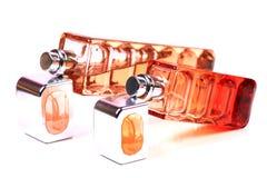Flessen van het glas de blauwe parfum royalty-vrije stock afbeelding