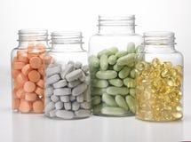 Flessen van tabletten Stock Afbeeldingen
