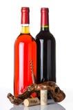 Flessen van wijn en een kurketrekker Royalty-vrije Stock Afbeeldingen