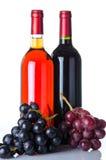 Flessen wijn en druiven Stock Foto