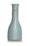 Flessenflessen en containers grijze verfdoos met een witte achtergrond Stock Foto