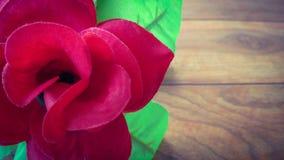 Fleur artificielle de rose de rouge de plan rapproché Image stock