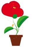 Fleur dans un en forme de coeur Images stock