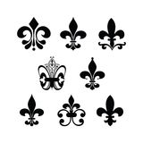 Fleur de lis. Set of different designs of fleur de lis symbols Stock Images