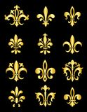 Fleur de Lis. Collection of traditional gold Fleur de Lis designs created in Adobe Illustrator.  isolated on black background Stock Photography