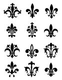 Fleur de Lis. Collection of traditional black Fleur de Lis designs created in Adobe Illustrator.  isolated on white background Royalty Free Stock Photo