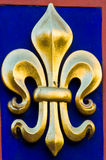 Fleur de lis. Close up of a golden fleur de lis royalty free stock photos