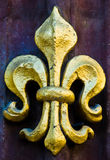 Fleur de lis. Close up of a golden fleur de lis stock photo