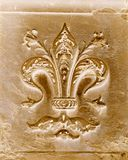 Fleur-de-lis carved in stone in Florence, Italy Royalty Free Stock Photography