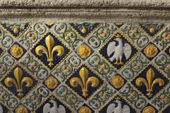 Fleur-de-lis pattern. A wall with Fleur-de-lis pattern at the Villa d'Este. Listed as a UNESCO world heritage site, Villa d'Este is a fine example of Renaissance royalty free stock photo