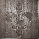 Fleur de lis relief on wooden background. Engraving style Stock Images