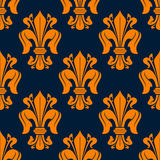 Fleur-de-lis seamless pattern with orange lilies Royalty Free Stock Photography