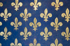 Fleur de lis wallpaper. Fleur-de-lis Pattern painted on a wall in Palazzo Vecchio - a museum in Florence, Italy. It is one of the oldest and most famous art Stock Photos